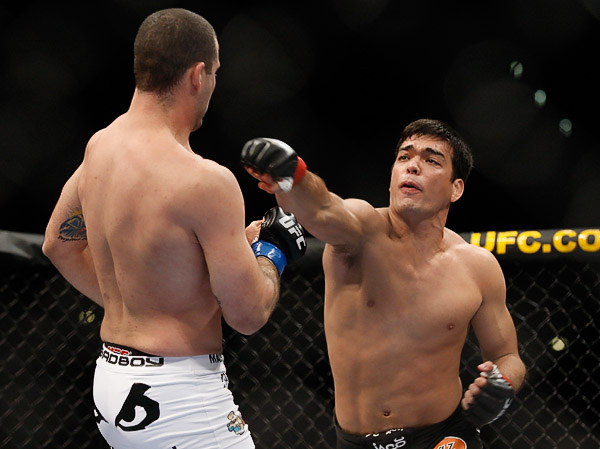 October 24, 2009; Los Angeles, CA; USA; Lyoto Machida (black trunks) throws a right hand at Mauricio Rua(white trunks) during their UFC light heavyweight championship bout at UFC 104. Machida won via controversial unanimous decison. Ed Mulholland for ESPN.com