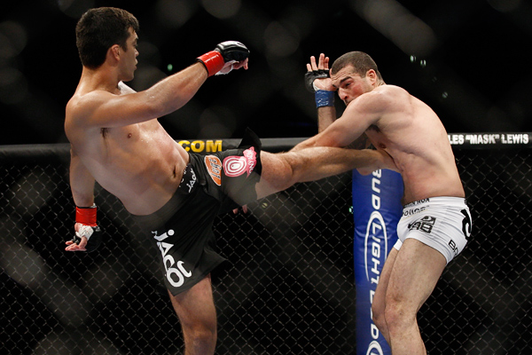 October 24, 2009; Los Angeles, CA; USA; Lyoto Machida (black trunks) throws a kick at Mauricio Rua(white trunks) during their UFC light heavyweight championship bout at UFC 104. Machida won via controversial unanimous decison . Mandatory Credit: Ed Mulholland