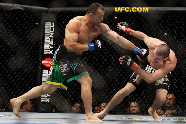 October 24, 2009; Los Angeles, CA; USA; Josh Neer (black trunks) takes a left hand from Gleison Tibau (black/green/yellow trunks) during their bout at UFC 104. Tibau won via unanimous decision. Ed Mulholland for ESPN.com