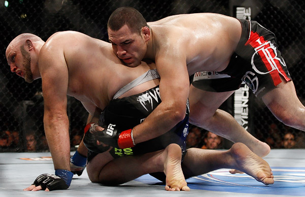 October 24, 2009; Los Angeles, CA; USA; Ben Rothwell (black/blue trunks) gets taken down by Cain Velasquez (black trunks) during their bout at UFC 104. Ed Mulholland