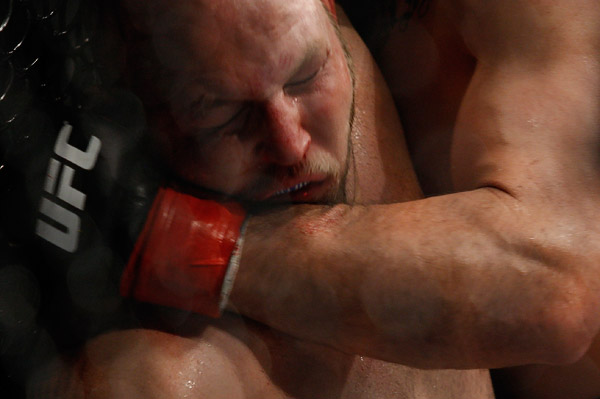 October 24, 2009; Los Angeles, CA; USA; Ben Rothwell (black/blue trunks) takes a punch from Cain Velasquez (black trunks) during their bout at UFC 104. Velasquez won via 2nd round stoppage. Ed Mulholland for ESPN.com