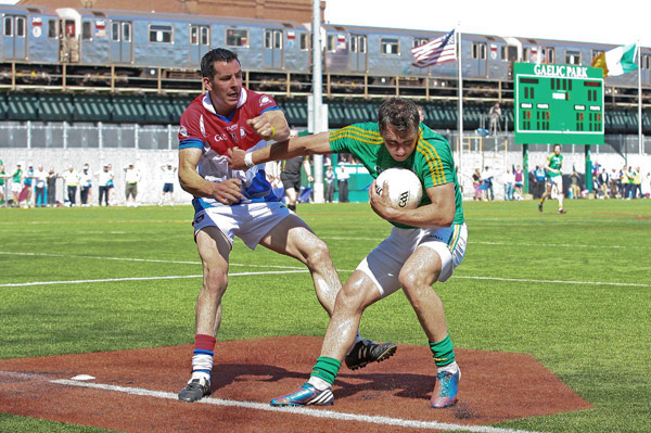 May 5, 2013; Bronx, NY; USA; Leitrim's Paul Brennan (10) is defended by New York's Jason Kelly (11) during the first half at Gaelic Park.